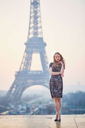 trocadero: Beautiful elegant Parisian woman near the Eiffel tower at early morning
