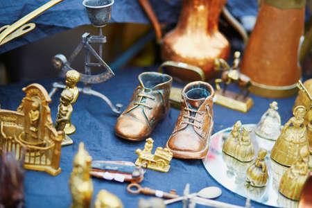 fleamarket: Bronze baby shoes on flea-market in Brugge, Belgium