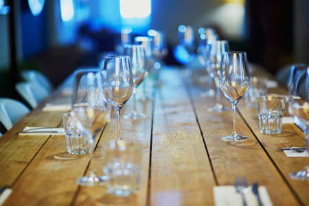 Row of wine glasses on the table in restaurant, bar or et wedding reception