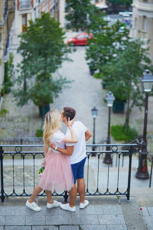 french kiss: Romantic couple kissing on Montmartre in Paris, France
