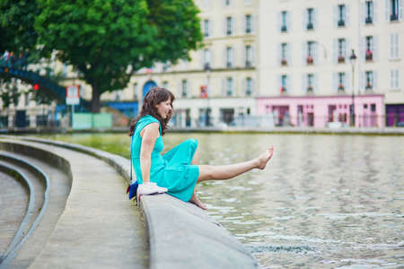 french woman: Cheerful young French woman having fun on Saint-Martin canal in Paris on a summer day