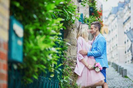 Romantic couple kissing on Montmartre in Paris, France