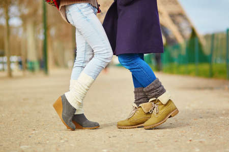 two girls hugging: Closeup of female legs, two girls hugging on the street in Paris, same-sex relationship concept