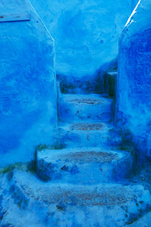 Closeup of staircase on a street in Chefchaouen, Morocco, small town in northwest Morocco known for its blue buildings Stock Photo