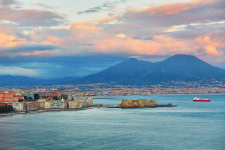 Aerial scenic view of Naples with Vesuvius volcano at sunset. Campania, Southern Italy