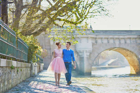 Young romantic couple on the Seine embankment in Paris, France Stock Photo
