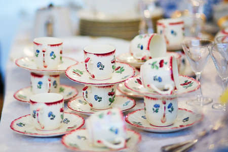 Many porcelain tea cups on flea market in Paris, France Reklamní fotografie