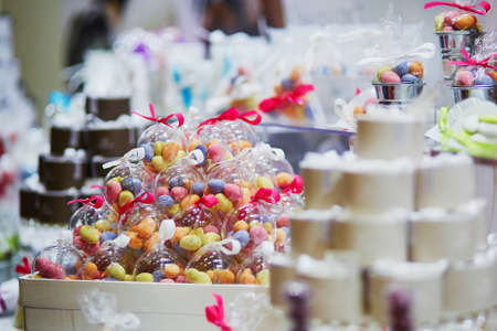 Colorful candies in transparent glass spheres at wedding reception or event party. Individual presents for guests Stock Photo
