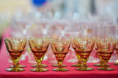 Many old crystal wine glasses on flea market in Paris, France Stock Photo