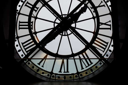 Large backlit clock in the Orsay Museum, Paris, France