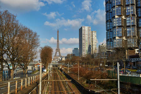 Unusual view to the Eiffel tower over the rails of Parisian subway line Stok Fotoğraf