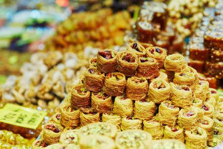 Heaps of various Turkish honey baklava on a traditional farmer market in Istanbul, Turkey Stock Photo