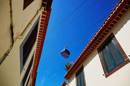 ropeway: Cable ropeway cabin over the roofs of buildings in Funchal, Madeira island, Portugal