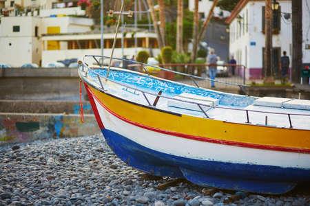 Colorful fishing boats on beach in Camara de Lobos, Madeira, Portugal Stock Photo