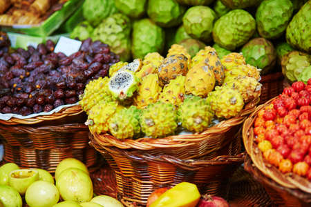 anona: Fresh and ripe exotic fruits on traditional farmer market Mercado dos Lavradores, Funchal, Madeira island, Portugal