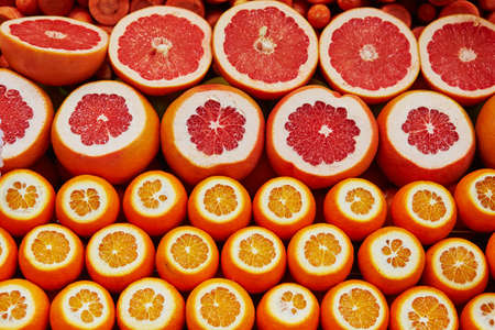 Many cut juicy oranges and grapefruits on a traditional farmer market in Istanbul, Turkey Stock Photo