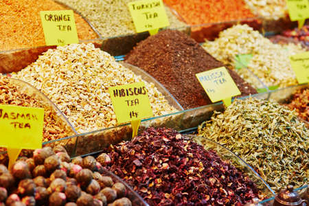 Heap of different spices and teas on a traditional farmer market in Istanbul, Turkey Stock Photo