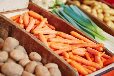Fresh organic carrot, potato and leek on farmers market in Paris, France