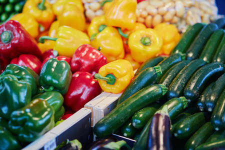 Fresh organic zuccini and bell pepper on farmers market in Paris, France