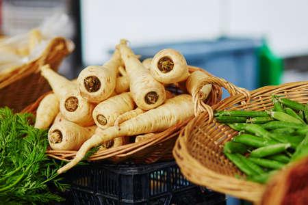 Fresh organic parsnip on farmers market in Paris, France Stock Photo - 76887885