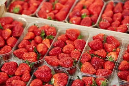 Large heap of fresh ripe organic strawberries on farmer market in Paris, France Standard-Bild
