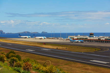 FUNCHAL - MARCH 24: View of runway in Cristiano Ronaldo International Airport on March 24, 2017 in Funchal, Madeira island, Portugal. FNC is considered as most dangerous runway in Europe Stock Photo