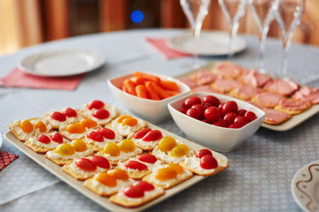Different finger food snacks with cheese and vegetables ready to eat on party or home dinner Stock Photo