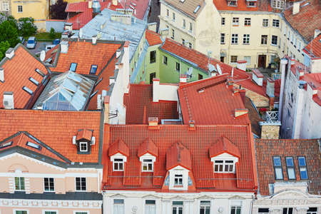 Beautiful colorful buildings with red tile roofs in Vilnius Old Town. Photo taken from Church of Saint Johns; Lithuania