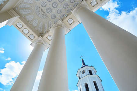 Bell tower of Vilnius cathedral over the blue sky with clouds. Old town of the capital of Lithuania