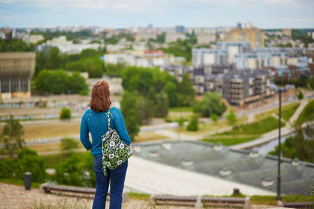 Girl looking at beautiful panorama of Vilnius Old Town from Gediminas hill, Lithuania