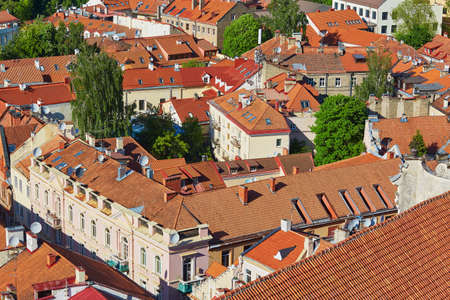 Beautiful colorful buildings with red tile roofs in Vilnius Old Town. Photo taken from Church of Saint Johns; Lithuania Reklamní fotografie - 82020905