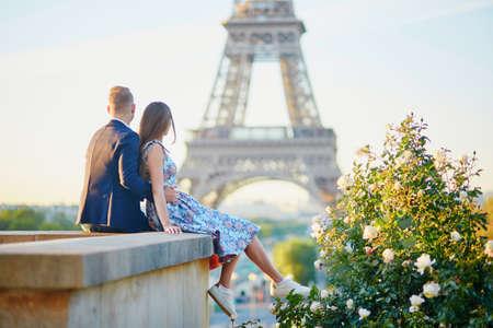 Romantic couple near the Eiffel tower in Paris, France Stock Photo