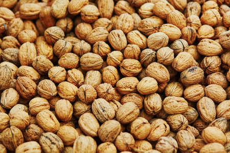 Large heap of walnuts on a market