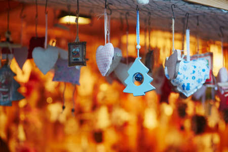 Variety of toys and decorations on traditional Christmas market in Strasbourg, Alsace, France