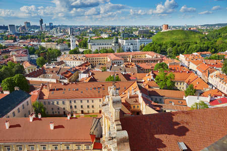 Beautiful panorama of Vilnius Old Town with Gediminas hill and Bell tower of Vilnius cathedral taken from Church of Saint Johns; Lithuania Stock Photo