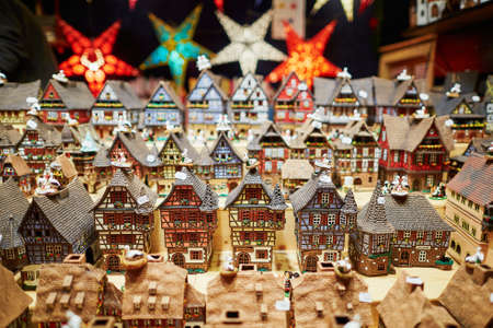 stock photo variety of ceramic houses and star garlands at traditional christmas market in strasbourg alsace france