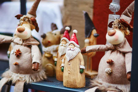 Wooden Santa and funny deers on traditional Christmas market in Strasbourg, Alsace, France