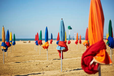 Famous colorful parasols on Deauville Beach, Normandy, Northern France, Europe