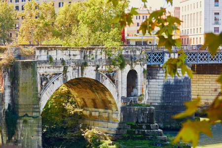 Old historical bridge over the Tiber in Rome, Italy Stock Photo