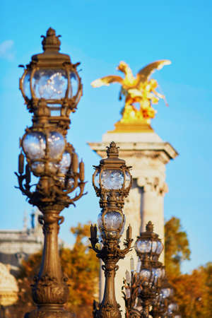 Beautiful lanterns of the famous Alexandre III bridge in Paris, France Stock fotó