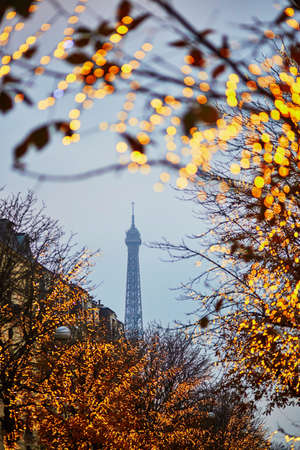 Winter holidays season in France. Scenic view of the Eiffel tower with Christmas illumination in Paris
