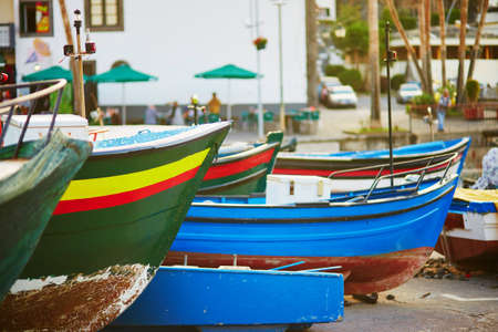 Colorful fishing boats on beach in Camara de Lobos, Madeira, Portugal Stock Photo