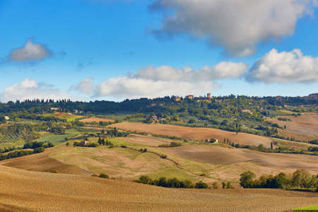 Scenic Tuscan landscape with beautiful fields, meadows and hills. San Quirico dOrcia, Tuscany, Italy Stock Photo