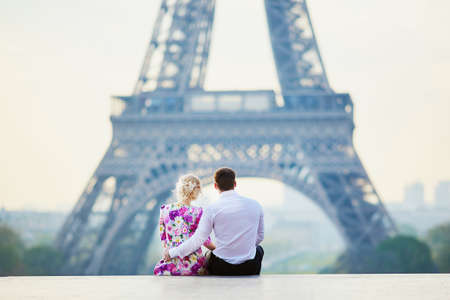 Beautiful romantic couple in front of the Eiffel tower in Paris, France Stock Photo
