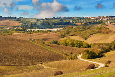 Scenic Tuscan landscape with beautiful fields, meadows and hills. San Quirico d'Orcia, Tuscany, Italy Stock Photo - 92606808