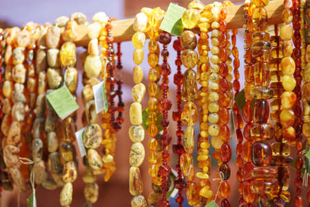 Amber necklaces sold on Easter fair in Vilnius, Lithuania. Traditional Lithuanian spring fair Reklamní fotografie