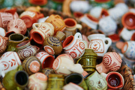 Handmade ceramic jugs sold on Easter fair in Vilnius, Lithuania. Traditional Lithuanian spring fair
