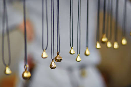 Metallic bells sold on Easter fair in Vilnius, Lithuania. Traditional Lithuanian spring fair Stock Photo