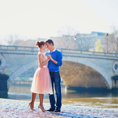 Romantic couple together in Paris near the river Seine