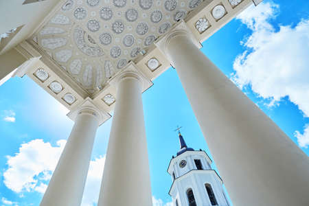Bell tower of Vilnius cathedral over the blue sky with clouds. Old town of the capital of Lithuania Reklamní fotografie - 96031355